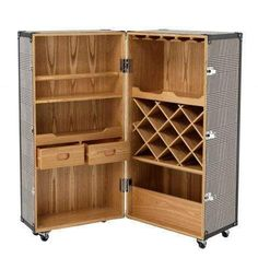 Inspired by antique campaign drinks cabinets, this elegant cocktail cabinet offers an integral top section glass holder, a storage rack for seven wine bottles, five open shelves and two drawers. The ash wood case features a dixon black and white houndstooth upholstery and finished with black leather look straps and nickel hardware. Six castor wheels make this trunk easily movable.Dimension: 59 x 59 x H. 122 cmClick here to view Specification Sheet Wooden Wine Cabinet, Wine Bar Cabinet, Drinks Cabinet, Wine Cabinets, Bar Storage Cabinet, Wine Storage, Storage Shelves, Locker Storage, Open Shelves