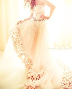 I love how detailed this flower dress is.... it would be like a fairy tail to walk down the isle in this on your wedding day!