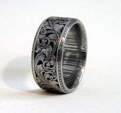 Wowza! Gorgeous..wish I could afford a his/hers set! http://www.cdmengraving.com/gun_jewelry.html
