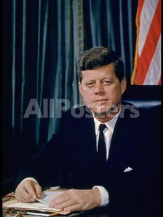 Pres. John F. Kennedy Sitting at His Desk, with Flag in Bkgrd People Photographic Print - 30 x 41 cm