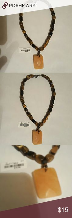 Necklace, made of Natural Stone This necklace has only been worn a few times, still has the price tag. It is in great condition. Not sure what type of stones this necklace is made of. Jewelry Necklaces