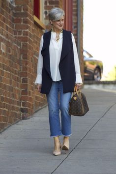 feminine route with a soft, flowing blouse tucked underneath. denim