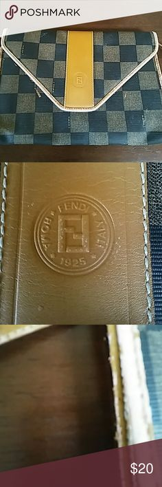 Vintage Fendi envelope clutch authentic. Used and well loved. Most of the wear appears on the piping. It features an embossed leather stamp. The strap is still attached but snaps allow for removal. Fendi Bags Clutches & Wristlets