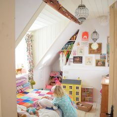 White kids bedroom filled with colourful accessories and yellow dolls house. Pic @florafairweather