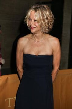 Meg Ryan continues to slay when it comes rocking curls & waves