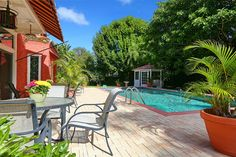 The property offers gardens, a pool, a paved terrace, and a gazebo.