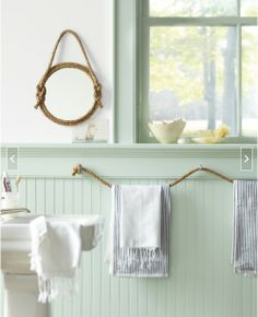 Cord rope as bathroom towel holder. Love this idea for a cottage.