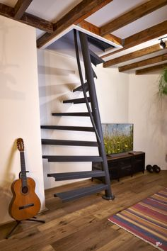 EeStairs is renowned for bespoke design, but did you know that we have a compact standard staircase available for limited space locations? The by EeStairs® is designed to suit situations where space is at a premium, such access to a loft room. Space Saving Staircase, Loft Staircase, Attic Stairs, House Stairs, Black Staircase, Stairs To Loft, Garden Stairs, Spiral Staircases, Basement Stairs