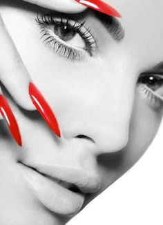 flawless skin and stiletto long red nails