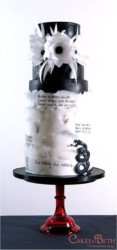 Nothing Else Matters. It is based around one of my favourite Metallica songs and an amazing track for your first dance. With torn rice paper, black leather and a sugar snake, all on a tall, cylindrical cake structure. Wafer Paper Flowers, Wafer Paper Cake, Cake Flowers, Wedding Cake Designs, Wedding Cakes, Wedding Ideas, Black White Cakes, Black Tie, Chalkboard Cake