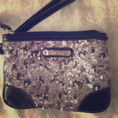 Nine West Sequin Metallic Wristlet Pre loved wristlet. All sequins are intact and there are no flaws or stains. It is 6 inches in length. Also has a patent leather trim. Perfect for going out and not having to carry a purse. Feel free to ask any questions :) Nine West Bags Clutches & Wristlets