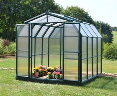 Grand Gardener 8′x8′ opaque manufactured from extruded dark green Resin thick frame with a natural isolating qualities in a barn shape style.