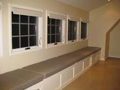 Custom window seat cushions made with Sunbrella Lorenzo Slate for a long  window seat in an upstairs gallery.