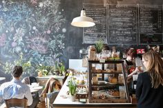 Astro Coffee in Detroit | Oh my gosh, that floral, chalkboard wall. I am swooning.