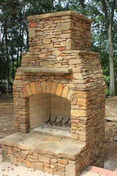 Stacked rock outdoor patio fireplace