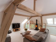 Attic | Interiors | Living room | Decor | Neutrals | Modern | Timber frame houses by Carpenter Oak Ltd