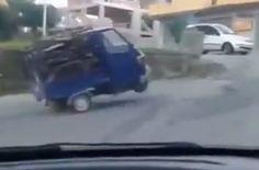 Funny Overloaded three-wheel Ape Piaggio in Italy