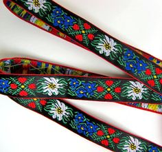 EDELWEISS & HEARTS Jacquard trim, 3 yards, White Blue red green yellow on black. Red edges. 5/8 inch wide. 956(2)-A
