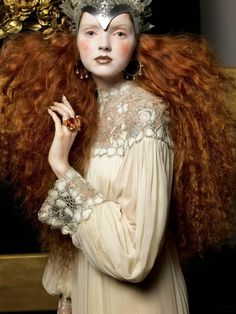Italian Vogue September 2005. Elizabethan influences and styles in hair and make-up. Pale skin and large frizzy hairstyles are used to re-create a new take on a classic look from history.