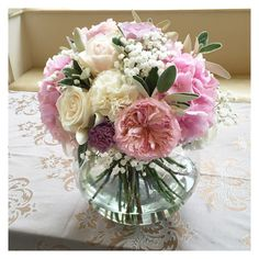 Pink rose, hydrangea and peony fish bowl wedding centrepiece. Surrey wedding flowers by Boutique Blooms floral design.