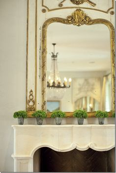For Spring...moss or greenery tucked into a collection of mint julep cups or mercury glass votives on the mantle