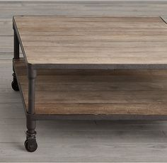 RH's Dutch Industrial Square Coffee Table:Our distressed table pairs the warmth of aged elm with warm, aged metal frames for an industrial, imperfect look.