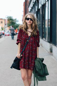 red hippie dress and black satchel. Green coat