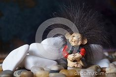 Beautiful background with a cute troll and stones Troll, Garden Sculpture, Stones, Bird, Outdoor Decor, Cute, Animals, Beautiful, Home Decor