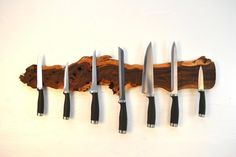 Magnetic knife holder I like the idea of having one of these made from wood that matches/complements the cabinet color
