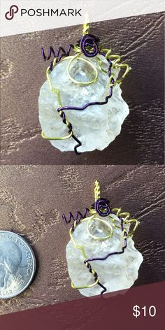 Rough cloudy clear quartz crystal pendant I wrapped this rough quartz crystal in purple and peridot wire as a pendant. That's all I can think for now. Jewelry