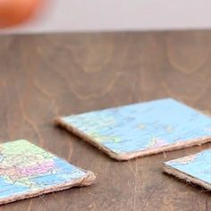Give the perfect handmade gift by creating these DIY coasters using a wood board, vintage maps and twine.