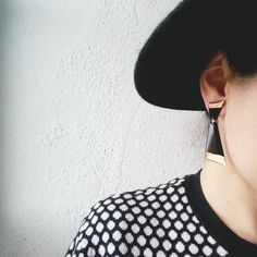 Geometric upcycled dangly stud earrings made from vinyl record by artist-jeweller Anne-Louise Laflamme from DANA Jewellery