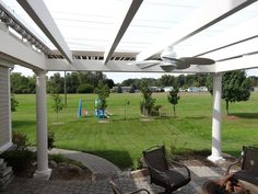Open center with retractable motorized awning. Left it open because in Michigan, a lot of times you WANT the sun! Curved Pergola, Rainbow Light, Strip Lighting, Michigan, Outdoor Structures, Sun, Lights, Times, Light Fixtures