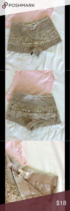 Sans Souci shorts Sans Souci crocheted layered lace shorts in excellent condition. Champagne color, size XS. Sans Souci Shorts