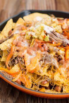 Hawaii's BEST pork nachos with pina colada sauce.
