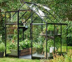 The Halls Qube 6 x 6 ft Greenhouse is part of the exciting new greenhouse range from Halls, bringing modern design, intuition and engineering to a traditional growing structure. Cheap Greenhouse, Greenhouse Effect, Greenhouse Interiors, Backyard Greenhouse, Greenhouse Wedding, Greenhouse Plans, Pallet Greenhouse, Autumn Garden, Water Plants