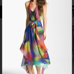 HP Stunning Rainbow Layered Chiffon Dress It Girl Host Pick  This dress is absolutely stunning!!! It's is has several layers of sheer chiffon with a stunning rainbow like print. The hem is a very flowy handkerchief cut that gives the dress tons of movement. When you float into a room with this dress on all eyes will be on you!   It was only worn once and there is a small tear in the inside lining but not visible while wearing it.  Reasonable offers are always considered Smoke and pet free…
