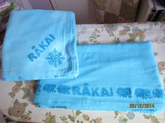 Muslin wraps for Rakai. Muslin sewn double. Stamped with Color Magnet then immersion dyed with Procion dye.