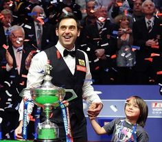 Ronnie O'Sullivan winning his world championship (with his son Ronnie Jr. Snooker World Champion, Ronnie O'sullivan, World Championship, Sons, Captain Hat, Darts, My Favorite Things, Jr, Blue Prints