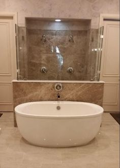 ReBath of Dallas did an amazing job of this Light Emperador marble slab shower and free standing tub combo with glass enclosure and swinging shower doors. Walk In Shower, Shower Doors, Emperador Marble, Sink, Bathtub, Bathroom Designs, Tubs, Traditional Design, Luxury