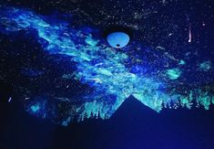 Artist and writer Crispin Young used glow-in-the-dark paint to create a star mural of epic proportions for his friends' son.