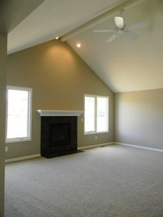 Great Room with cathedral ceiling, gas fireplace and ceramic surround