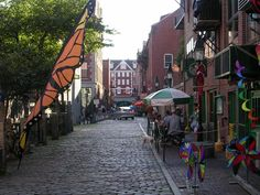 Portland Maine's Old Port district is known for its cobblestone streets, historic brick buildings and lively working waterfront.  Portland's historic district is lined with unique shops and many restaurants leading some visitors to refer to Portland as a foodie's paradise.  Credit: John Grossmann http://www.everettpotter.com/2011/07/maine-attraction-the-pleasures-of-portland/
