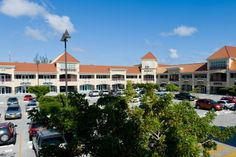 Cayman Property | Cayman Real Estate - Governors Square, Price: US$40, Grand Cayman - Price: US$40/Per Sft - West Bay Roads premier retail and office park. Category 5 hurricane rated with full back up power and water available. On site security and an excess of parking available. 2nd floor office space and ground floor retail available. Call or email for details.