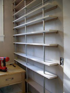 Awesome diy pantry shelves for only $180 (the other side of the pantry has shelves, too) Lots and lots of shelves :)