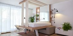 Atelier @decadrages built a sliding bed that can be stored in the ceiling. More on ignant.de...
