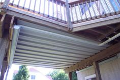 How to keep the ground/basement dry under a deck.  genius!