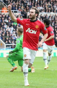 @manutd forward Juan Mata milks the applause after bagging a brace in the Reds' 4-0 win over Newcastle United at St. James' Park.