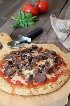 Paleo Pizza Crust! Crunchy on the outside and fluffy on the inside. Chose your toppings or follow this recipe for a Meat Lovers Pizza!