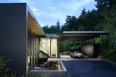 This house is a complete reconstruction of one of iconic Seattle architect Fred Bassetti's earliest designs.  The entry approach was redesigned with a cantilevered concrete landing in the sunken Courtyard and a large glass pivot door.all photography by Benjamin Benshneider